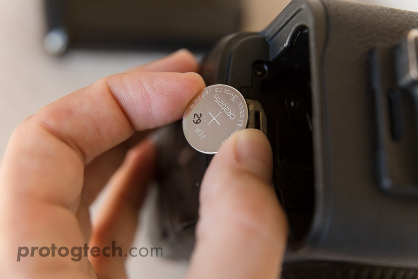 Carefully lift out the CR2025 battery. Always try to handle watch batteries by the edges.