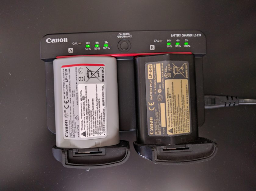 Photo of Canon's LC-E19 charger charging both LP-E19 and LP-E4N battery packs.